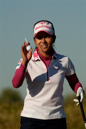 PRATTVILLE, AL - OCTOBER 7: Ai Miyazato of Japan raises her golf ball to acknowledge the gallery during the first round of the Navistar LPGA Classic at the Senator Course at the Robert Trent Jones Golf Trail at Capitol Hill on October 7, 2010 in Prattville, Alabama. (Photo by Darren Carroll/Getty Images)