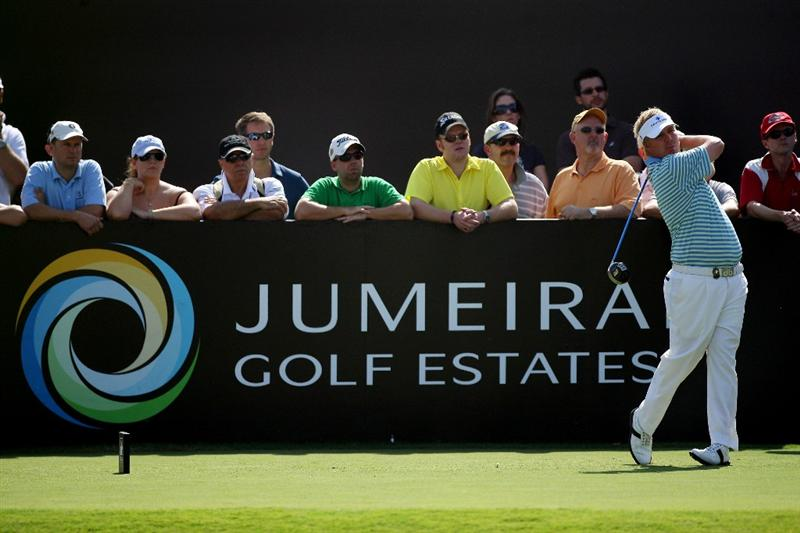 DUBAI, UNITED ARAB EMIRATES - NOVEMBER 21:  Ross McGowan of England plays his tee shot at the 3rd hole during the third round of the Dubai World Championship, on the Earth Course, Jumeirah Golf Estates on November 21, 2009 in Dubai, United Arab Emirates  (Photo by David Cannon/Getty Images)