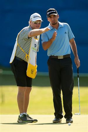 IRVING, TX - MAY 26: Jason Day of Australia and caddie Colin Swatton read a putt during the first round of the HP Byron Nelson Championship at TPC at Las Colinas on May 26, 2011 in Irving, Texas. (Photo by Darren Carroll/Getty Images)