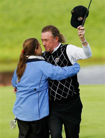 NEWPORT, WALES - OCTOBER 03:  Miguel Angel Jiminez of Europe is embraced by partner Marian Jimenez  during the  Fourball & Foursome Matches during the 2010 Ryder Cup at the Celtic Manor Resort on October 3, 2010 in Newport, Wales. (Photo by Sam Greenwood/Getty Images)