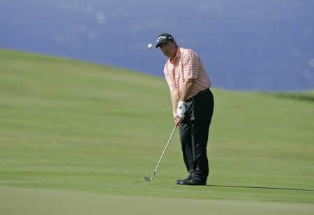 Olin Browne chips a shot onto the fourth green during the third round of the PGA TOUR's Mercedes Open, January 7, 2006 at the Plantation Course on Kapalua Resort in Kapalua, Maui, Hawaii.Photo by Marco Garcia/PGA TOUR/WireImage.com