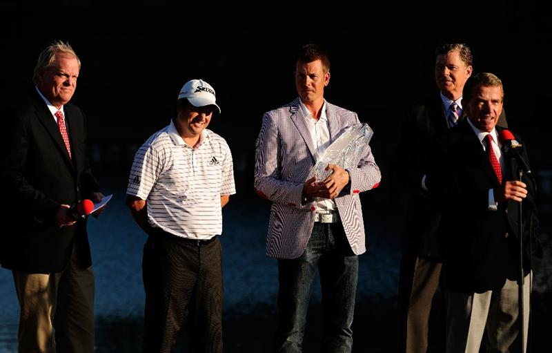 PONTE VEDRA BEACH, FL - MAY 09:  Tim Finchem Commissioner of the PGA Tour (R), speaks at the trophy presentation where defending champion Henrik Stenson of Sweden (3rd R) will award Tim Clark of South Africa the trophy as Johnny Miller (L) and Dan Patrick (2nd R) of NBC look on during the trophy presentation after he won THE PLAYERS Championship held at THE PLAYERS Stadium course at TPC Sawgrass on May 9, 2010 in Ponte Vedra Beach, Florida.  (Photo by Sam Greenwood/Getty Images)