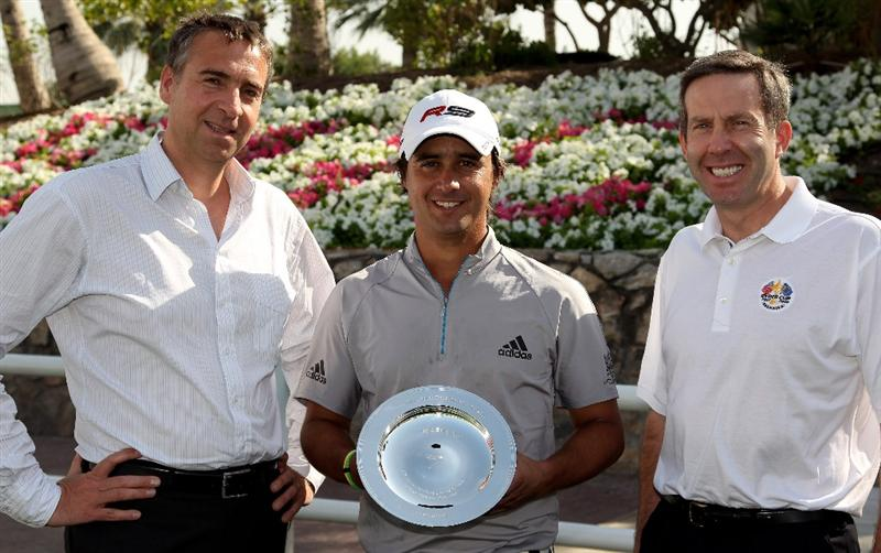 DUBAI, UNITED ARAB EMIRATES - FEBRUARY 03:  Marco Kausler of BMW, Rafa Echenique of Argentina with The European Tour Shot of the Year trophy for 2009 and Keith Waters, The European Tour's Director of International Policy pictured prior to the Omega Dubai Desert Classic on the Majlis Course at the Emirates Golf Club on February 3, 2010 in Dubai, United Arab Emirates.  (Photo by Ross Kinnaird/Getty Images)