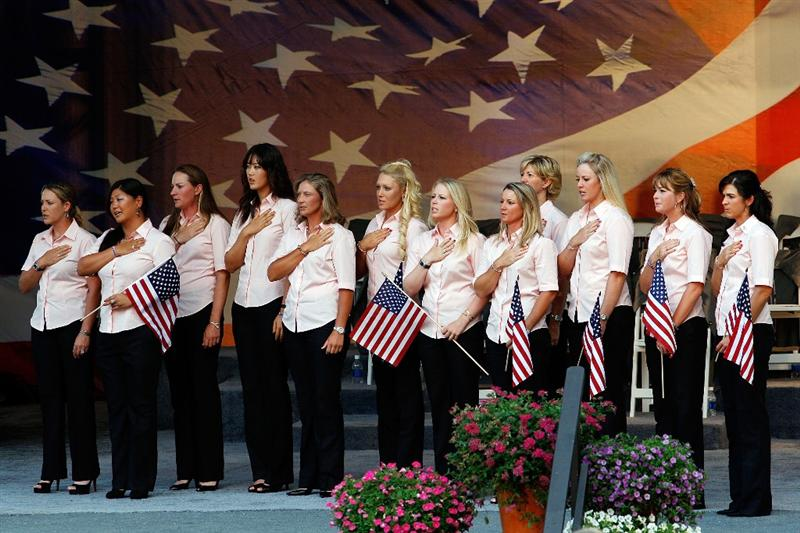 SUGAR GROVE, IL - AUGUST 20:  Members of the U.S. Team  stand during the National Anthem during the opening ceremonies for the 2009 Solheim Cup at Rich Harvest Farms on August 20, 2009 in Sugar Grove, Illinois.  (Photo by Chris Graythen/Getty Images)