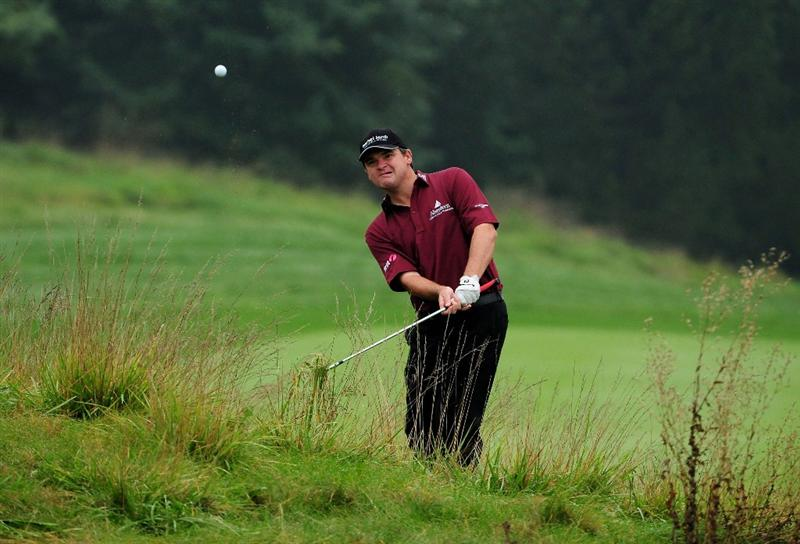 VIENNA, AUSTRIA - SEPTEMBER 17:  Paul Lawrie of Scotland plays from deep rough on the 15th during the first round of the Austrian Golf Open at Fontana Golf Club on September 17, 2009 in Vienna, Austria.  (Photo by Richard Heathcote/Getty Images)
