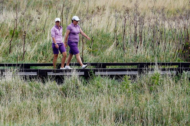 SUGAR GROVE, IL - AUGUST 20:  Gwladys Nocera, left and Becky Brewerton of the European Team walk up to the first fairway during a practice round prior to the start of the 2009 Solheim Cup at Rich Harvest Farms on August 20, 2009 in Sugar Grove, Illinois.  (Photo by Chris Graythen/Getty Images)