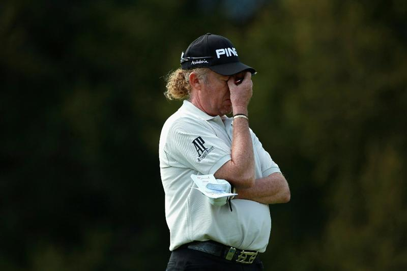 CRANS, SWITZERLAND - SEPTEMBER 04:  Miguel Angel Jimenez of Spain holds his hand to his face during the third round of The Omega European Masters at Crans-Sur-Sierre Golf Club on September 4, 2010 in Crans Montana, Switzerland.  (Photo by Warren Little/Getty Images)
