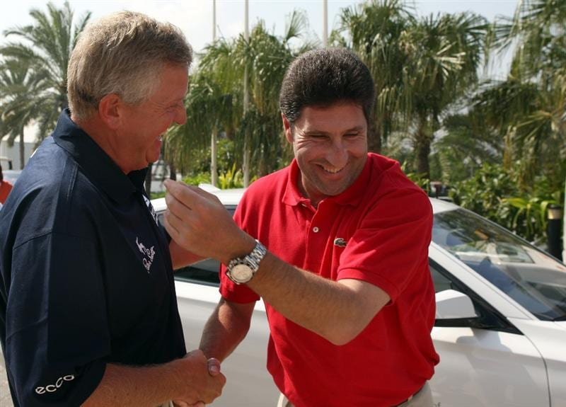 DUBAI, UNITED ARAB EMIRATES - JANUARY 29:  Colin Montgomerie of Scotland, the 2010 Ryder Cup Captain  meets Jose Maria Olazabal of Spain for the first time after the anouncment of the captaincy before their first round of the Dubai Desert Classic on the Majlis Course on January 29, 2009 in Dubai,United Arab Emirates.  (Photo by Ross Kinnaird/Getty Images)