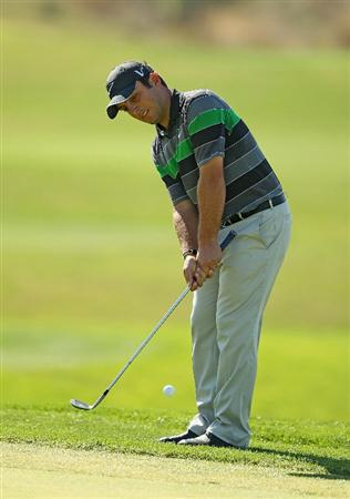 VILAMOURA, PORTUGAL - OCTOBER 17:  Francesco Molinari of Italy chips onto the 13th green during the final round of the Portugal Masters at the Oceanico Victoria Golf Course on October 17, 2010 in Vilamoura, Portugal.  (Photo by Richard Heathcote/Getty Images)