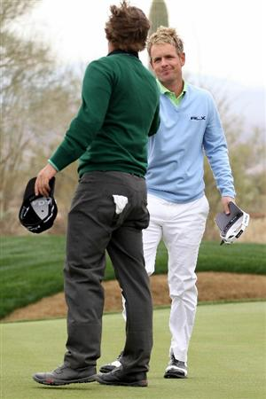 MARANA, AZ - FEBRUARY 26:  Ryan Moore (L) congratulates Luke Donald of England (R) on his win on the 14th hole during the quarterfinal round of the Accenture Match Play Championship at the Ritz-Carlton Golf Club on February 26, 2011 in Marana, Arizona.  (Photo by Andy Lyons/Getty Images)