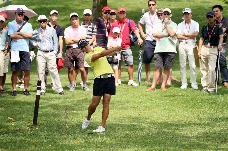 SINGAPORE - FEBRUARY 27:  Yani Tseng of Taiwan hits her second shot on the 6th hole during the third round of the HSBC Women's Champions at Tanah Merah Country Club on February 27, 2010 in Singapore, Singapore.  (Photo by Andy Lyons/Getty Images)