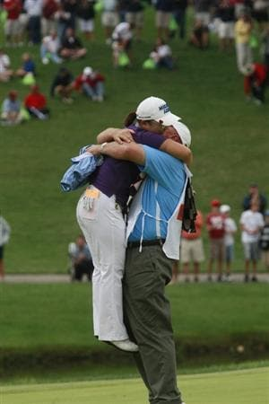 ROGERS, AR - SEPTEMBER 13:  LPGA golfer Jiyai Shin is lifted by her caddie Dean Herden after winning the P&G Beauty NW Arkansas Championship at the Pinnacle Country Club on September 13, 2009 in Rogers, Arkansas. Shin won after a two-hole playoff.  (Photo by Dave Martin/Getty Images)