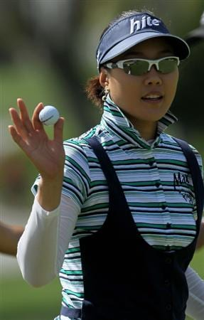 CARLSBAD, CA - MARCH 27:  Hee Kyung Seo of South Korea holds up her ball after making a birdie on the third hole during the third round of the Kia Classic Presented by J Golf at La Costa Resort and Spa on March 27, 2010 in Carlsbad, California.  (Photo by Stephen Dunn/Getty Images)