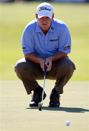 LAKE BUENA VISTA, FL - NOVEMBER 14:  Johnson Wagner hits looks over a shot on the 3rd hole during the final round of the Children's Miracle Network Classic at the Disney Magnolia course on November 14, 2010 in Lake Buena Vista, Florida.  (Photo by Sam Greenwood/Getty Images)