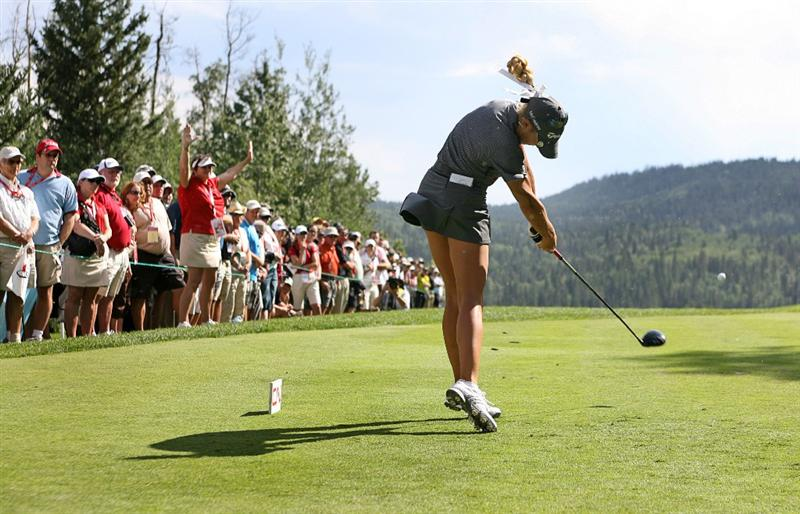 CALGARY, AB - SEPTEMBER 03: Natalie Gulbis of the United States hits her tee shot on the 10th hole during the first round of the Canadian Women's Open at Priddis Greens Golf & Country Club on September 3, 2009 in Calgary, Alberta, Canada. (Photo by Hunter Martin/Getty Images)