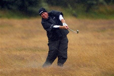 SOUTHPORT, UNITED KINGDOM - JULY 17:  John Daly of USA hits out of the rough on the 1st hole during the First Round of the 137th Open Championship on July 17, 2008 at Royal Birkdale Golf Club, Southport, England.  (Photo by Andrew Redington/Getty Images)