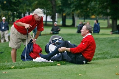 Woody Austin laughs with his caddie after he fell in the water on 14 during the second round of competition for The Presidents Cup on September 28, 2007, at The Royal Montreal Golf Club in Montreal, Quebec, Canada. PGA TOUR - 2007 The Presidents Cup - Second RoundPhoto by Caryn Levy/PGA TOUR/WireImage.com