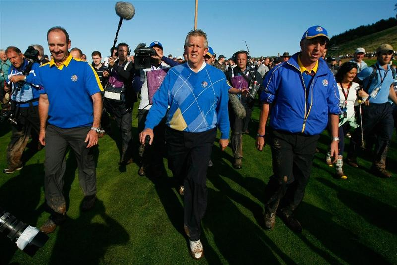 NEWPORT, WALES - OCTOBER 04:  Europe Team Captain Colin Montgomerie walks back to the clubhouse following Europe's victory in the 2010 Ryder Cup at the Celtic Manor Resort on October 4, 2010 in Newport, Wales.  (Photo by Tom Dulat/Getty Images)