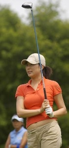 Shi Hyun Ahn wathces her tee shot on the 18th hole during the second round of the Wegmans LPGA at Locust Hill Country Club in Rochester, New York on Friday, June 23, 2006.Photo by Kevin Rivoli/WireImage.com