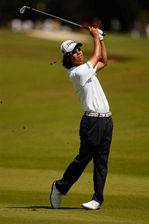 RIVIERA MAYA, MEXICO - MARCH 01:  Kevin Na makes a shot from the fairway on the 3rd hole during the final round of the Mayakoba Golf Classic on March 1, 2009 at El Camaleon Golf Club in Riviera Maya, Mexico.  (Photo by Chris Graythen/Getty Images)