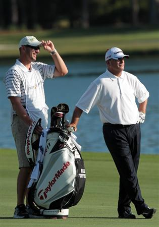PONTE VEDRA BEACH, FL - MAY 15:  Paul Goydos (R) and caddie Chris Mazziotti (L) look on from the 18th fairway during the final round of THE PLAYERS Championship held at THE PLAYERS Stadium course at TPC Sawgrass on May 15, 2011 in Ponte Vedra Beach, Florida. Goydos finished with a 3-under-par 69.  (Photo by Scott Halleran/Getty Images)