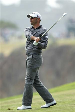PEBBLE BEACH, CA - JUNE 20:  Gregory Havret of France watches his approach shot on the tenth hole during the final round of the 110th U.S. Open at Pebble Beach Golf Links on June 20, 2010 in Pebble Beach, California.  (Photo by Andrew Redington/Getty Images)