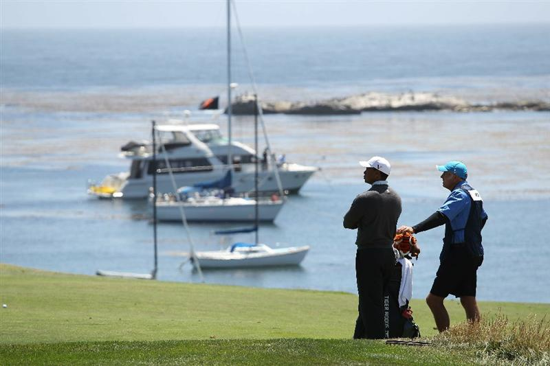 PEBBLE BEACH, CA - JUNE 17:  Tiger Woods and his caddie Steve Williams wait to play on the fourth hole during the first round of the 110th U.S. Open at Pebble Beach Golf Links on June 17, 2010 in Pebble Beach, California.  (Photo by Ross Kinnaird/Getty Images)