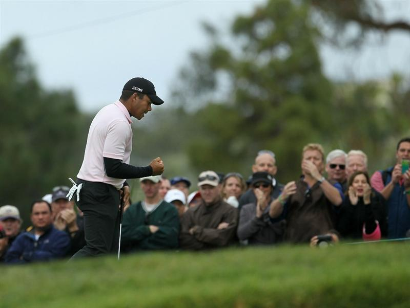 LA JOLLA, CA - JANUARY 30:  Jhonattan Vegas of Venzuela pumps his fist after making his par putt on the 17th hole during the final round of the Farmers Insurance Open at Torrey Pines South Course on January 30, 2011 in La Jolla, California.  (Photo by Stephen Dunn/Getty Images)