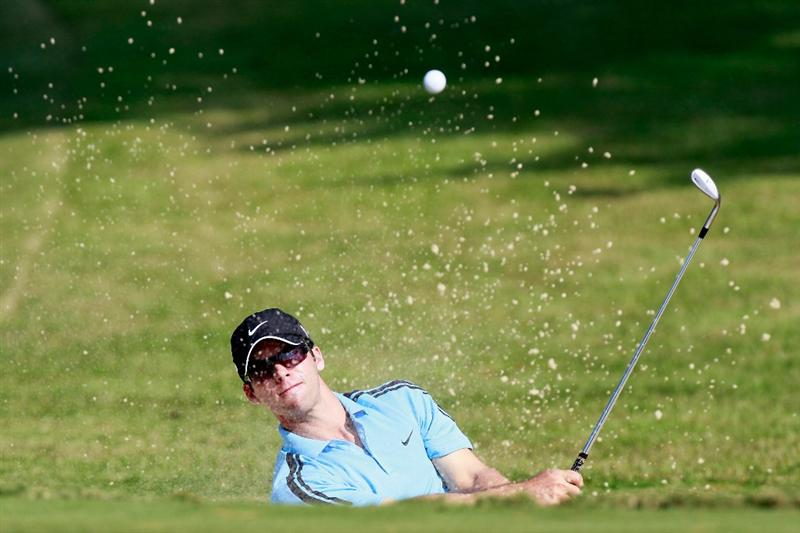 ATLANTA - SEPTEMBER 23:  Paul Casey of England chips out of the sand onto the 14th green during the first round of THE TOUR Championship presented by Coca-Cola at East Lake Golf Club on September 23, 2010 in Atlanta, Georgia.  (Photo by Kevin C. Cox/Getty Images)