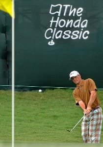 Nick Thompson chips into the 18th green during a Pro Am at the 2006 Honda Classic March 6 at the Country Club at Mirasol in Palm Beach Gardens, Florida.Photo by Al Messerschmidt/WireImage.com
