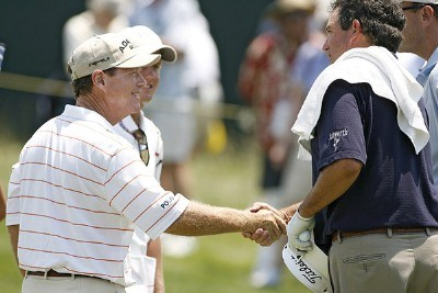 Tom Watson and Bruce Lietzke shake hands after finishing up during the second round of the Greater Kansas City Golf Classic at the Nicklaus Golf Club at LionsGate in Overland Park, Kansas on July 1, 2006.Photo by G. Newman Lowrance/WireImage.com