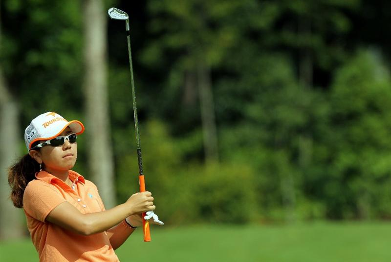 KUALA LUMPUR, MALAYSIA - OCTOBER 24:  Mika Miyazato of Japan watches her 2nd shot on the 1st hole during the Final Round of the Sime Darby LPGA on October 24, 2010 at the Kuala Lumpur Golf and Country Club in Kuala Lumpur, Malaysia. (Photo by Stanley Chou/Getty Images)