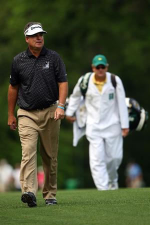 AUGUSTA, GA - APRIL 11:  Kenny Perry walks with his caddie Fred Sanders on the third hole during the third round of the 2009 Masters Tournament at Augusta National Golf Club on April 11, 2009 in Augusta, Georgia.  (Photo by Andrew Redington/Getty Images)