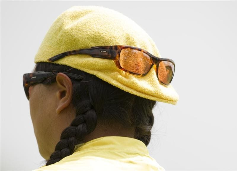 CHON BURI, THAILAND - FEBRUARY 21:  Christina Kim of USA wears two pairs of sunglasses during the final round of the Honda PTT LPGA Thailand at Siam Country Club on February 21, 2010 in Chon Buri, Thailand.  (Photo by Victor Fraile/Getty Images)