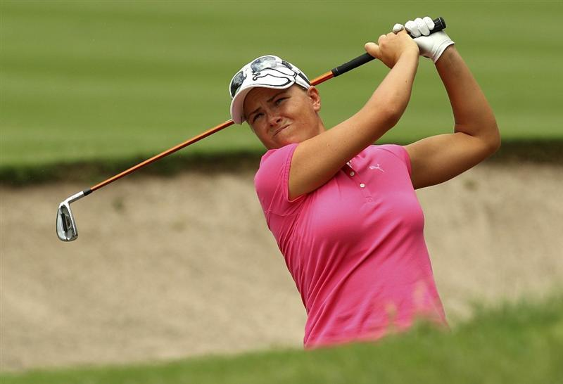 MELBOURNE, AUSTRALIA - FEBRUARY 04:  Lee-Anne Pace of South Africa plays a shot out of the bunker during day two of the Women's Australian Open at The Commonwealth Golf Club on February 4, 2011 in Melbourne, Australia.  (Photo by Lucas Dawson/Getty Images)