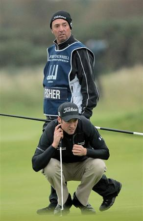 CARNOUSTIE, SCOTLAND - OCTOBER 09:  Ross Fisher of England with his caddie of the 13th green during the third round of The Alfred Dunhill Links Championship at the Carnoustie Golf Links on October 9, 2010 in Carnoustie, Scotland.  (Photo by David Cannon/Getty Images)