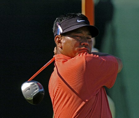 K. J. Choi drives from the 18th  tee as  play in the final holes of the third round continues at  the Bay Hill Invitational March 20, 2005 in Orlando.