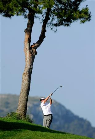 MALLORCA, SPAIN - MAY 13:  Philip Golding of England plays his approach shot on the 12th hole during the first round of the Open Cala Millor Mallorca at Pula golf club on May 13, 2010 in Mallorca, Spain.  (Photo by Stuart Franklin/Getty Images)