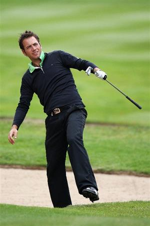 WENTWORTH, ENGLAND - MAY 20:  Nick Dougherty of England plays his second shot on the 3rd hole during the Pro Am at the BMW PGA Championship at Wentworth on May 20, 2009 in Virginia Water, England.  (Photo by Ross Kinnaird/Getty Images)