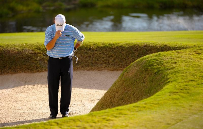 SAN ANTONIO - OCTOBER 25:  Jay Haas reacts after he sees his ball stop close to the cup as he misses the tying par on the 18th hole during the final round of the PGA Champions Tour AT&T Championship at the Oak Hills Country Club on October 25, 2009 in San Antonio, Texas.  (Photo by Robert Laberge/Getty Images)