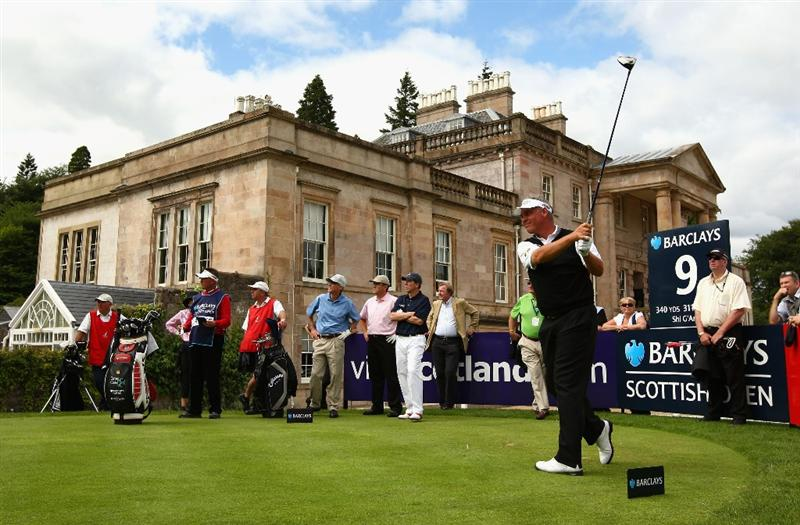 LUSS, UNITED KINGDOM - JULY 08:   Darren Clarke of Northern Ireland tees off on the 9th hole during the Pro Am prior to The Barclays Scottish Open at Loch Lomond Golf Club on July 08, 2009 in Luss, Scotland. (Photo by Richard Heathcote/Getty Images)