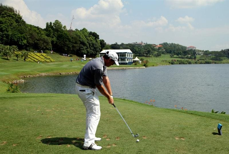 KUALA LUMPUR, MALAYSIA - OCTOBER 28: Marcus Fraser of Australia tees off on the 16th hole during day one of the CIMB Asia Pacific Classic at The MINES Resort & Golf Club on October 28, 2010 in Kuala Lumpur, Malaysia. (Photo by Stanley Chou/Getty Images)