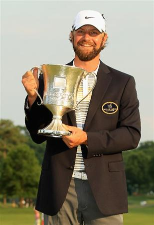 CHARLOTTE, NC - MAY 08:  Lucas Glover poses with the trophy after defeating Jonathan Byrd on the first playoff hole during the final round of the Wells Fargo Championship at the Quail Hollow Club on May 8, 2011 in Charlotte, North Carolina.  (Photo by Streeter Lecka/Getty Images)