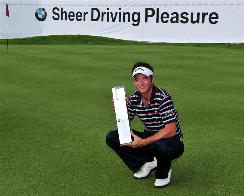 MUNICH, GERMANY - JUNE 28:  Nick Dougherty of England holds the trophy after winning The BMW International Open Golf at The Munich North Eichenried Golf Club on June 28, 2009, in Munich, Germany.  (Photo by Stuart Franklin/Getty Images)