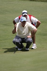 Jarrod Lyle of Australia and his caddie during the final round of the Jacob's Creek Open Championship, February 19, 2006, held at Royal Adelaide Golf Club, Adelaide, Australia.Photo by Jamie McDonald/WireImage.com