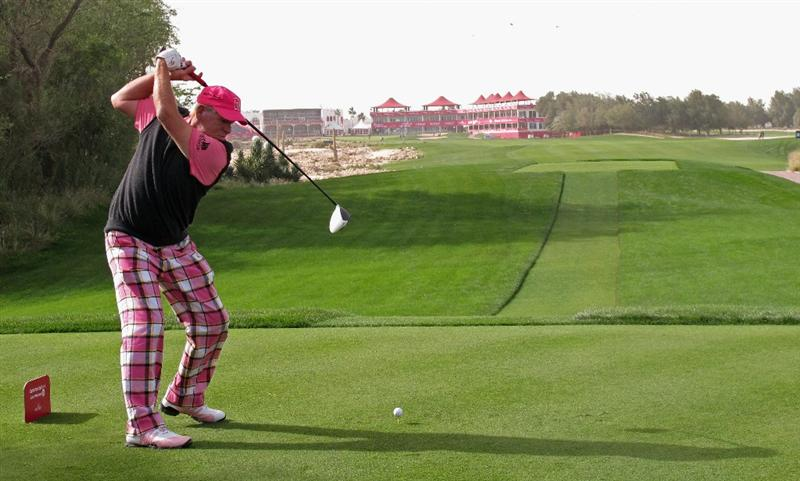 DOHA, QATAR - FEBRUARY 03:  John Daly of the USA hits his tee-shot on the 18th hole during the first round of the Commercialbank Qatar Masters held at Doha Golf Club on February 3, 2011 in Doha, Qatar.  (Photo by Andrew Redington/Getty Images)