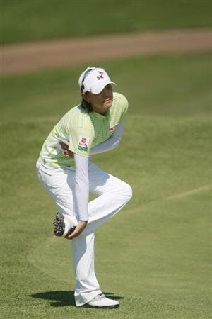 PRATTVILLE, AL - OCTOBER 1:  Na Yeon Choi of South Korea stretches on the ninth green after completing her first round play in the Navistar LPGA Classic at the Robert Trent Jones Golf Trail at Capitol Hill on October 1, 2009 in  Prattville, Alabama.  (Photo by Dave Martin/Getty Images)