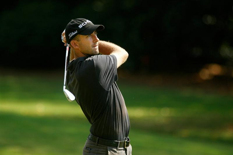 ATLANTA - SEPTEMBER 25:  Geoff Ogilvy of Australia watches his second shot on the 16th hole during the third round of THE TOUR Championship presented by Coca-Cola at East Lake Golf Club on September 25, 2010 in Atlanta, Georgia.  (Photo by Scott Halleran/Getty Images)