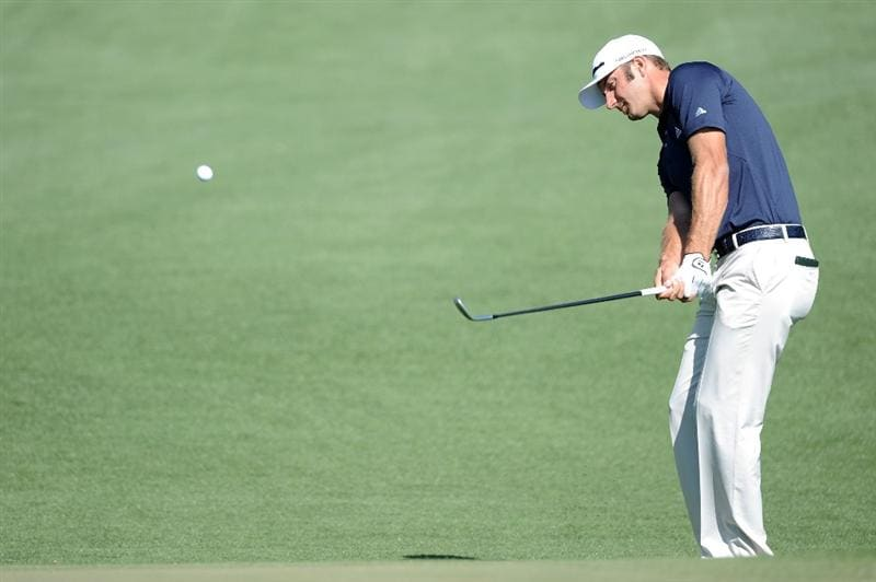 AUGUSTA, GA - APRIL 04:  Dustin Johnson hits a shot during a practice round prior to the 2011 Masters Tournament at Augusta National Golf Club on April 4, 2011 in Augusta, Georgia.  (Photo by Harry How/Getty Images)