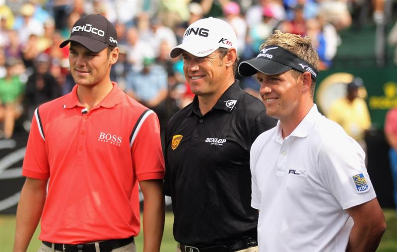 DORAL, FL - MARCH 10:  (L-R) Martin Kaymer of Germany, Lee Westwood and Luke Donald of England, the top-ranked players in the world, pose on the first tee during the first round of the 2011 WGC- Cadillac Championship at the TPC Blue Monster at the Doral Golf Resort and Spa on March 10, 2011 in Doral, Florida.  (Photo by Mike Ehrmann/Getty Images)